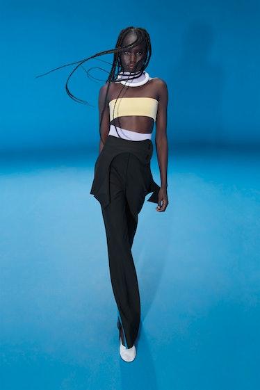 Model wears Nina Ricci spring 2022 collection at Paris Fashion Week.
