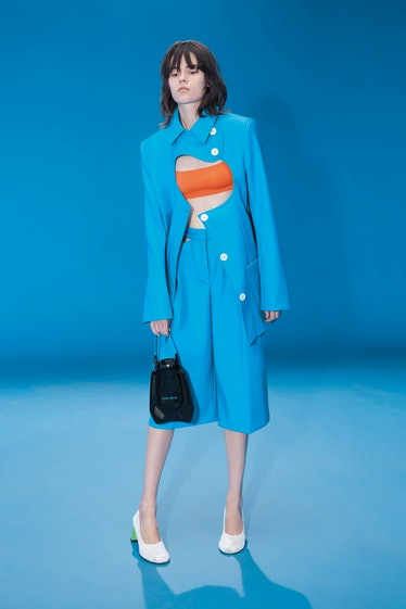 Model wears blue cut out suit from Nina Ricci's spring 2022 collection.