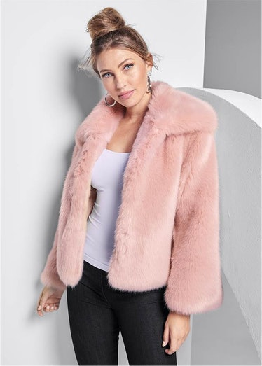 Peach wears a pink fur coat on 'You.'