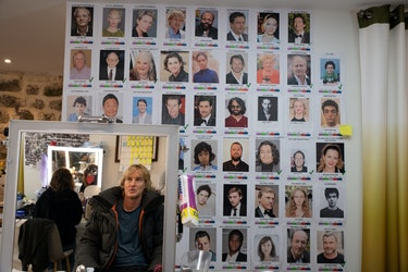 Owen Wilson, outfitted for the felt factory's February chill, examines a face sheet in one of the on...