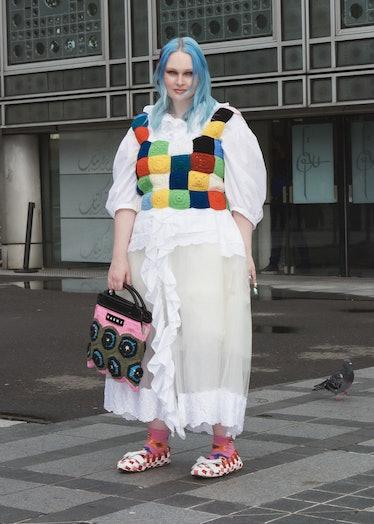 Kristen Bateman in white dress, crochet vest and Marni bag.