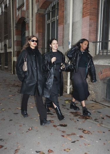 Three showgoers at Paris Fashion Week dressed all in black.