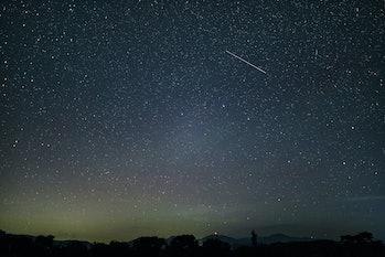 A single meteor in the night sky.