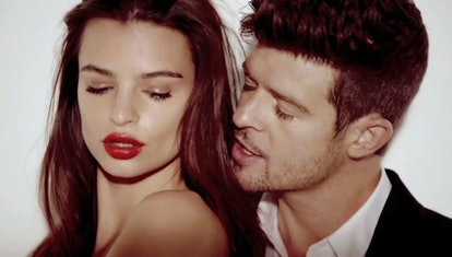 """Emily Ratajkowski and Robin Thicke in the """"Blurred Lines"""" music video."""
