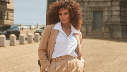 Model wears a tan two-piece suit and white collared shirt from 11 Honoré's collection with Nordstrom...