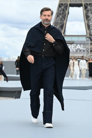 Nikolaj Coster-Waldau walking the L'Oréal spring 2022 runway