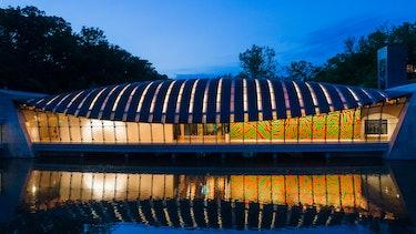the crystal bridges museum illuminated at night