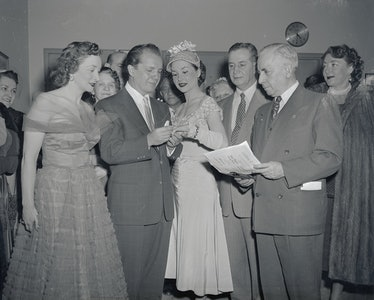 Cindy Adams and her husband, comedian Joey Adams, and others.