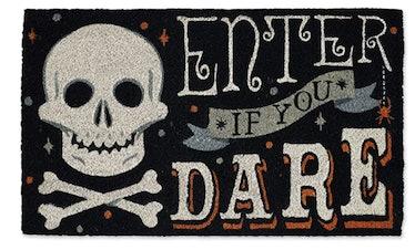 These Halloween doormats include spooky skulls.