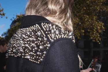 Close up of a spikey jacket at Paris Fashion Week.