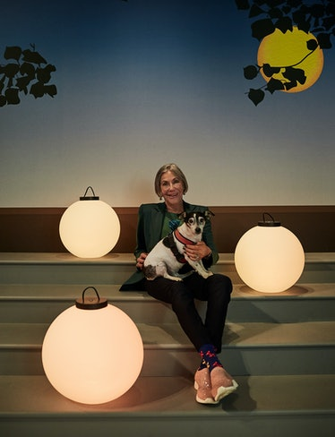 Alice Walton and her dog, Friday Walton, with lanterns inspired by Maxfield Parrish's The Lantern Be...