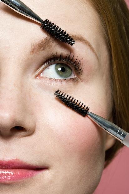 Woman using lash wands around eyes