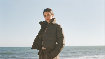 Kendall Jenner wears a cropped puffer jacket from Alo Yoga in her latest campaign, released on Octob...
