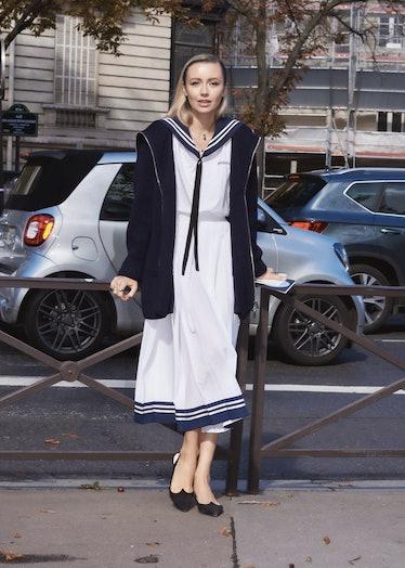 Nataly Osmann in sailor dress outside the Miu Miu spring 2022 show at Paris Fashion Week.
