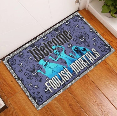 These Halloween doormats include Haunted Mansion options.
