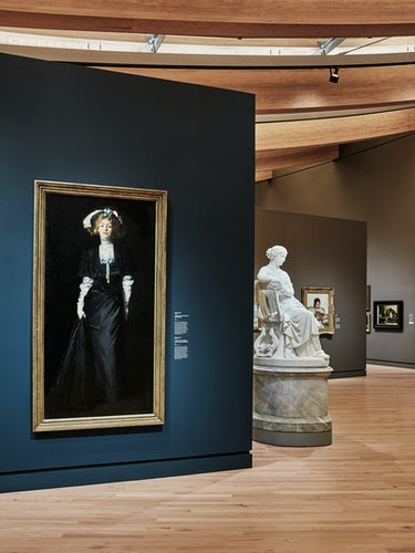 Robert Henri's Jessica Penn in Black With White Plumes (left), 1908, on display with William Wetmore...