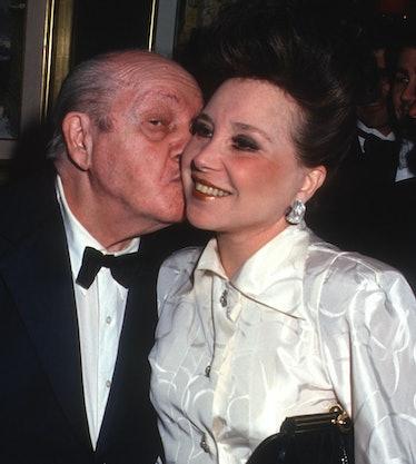 Joey Adams kissing his wife, Cindy.