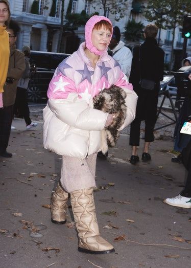 Courtney Trop in starred puffer coat, pink bonnet at the Miu Miu spring 2022 show at Paris Fashion W...
