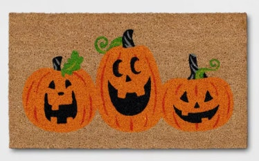 These Halloween doormats include a classic trio of Jack-O-Lanterns.