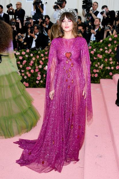Dakota Johnson attends The 2019 Met Gala while wearing Gucci.