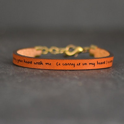 leather bracelet with words I Carry Your Heart from EE Cummings burned into the leather
