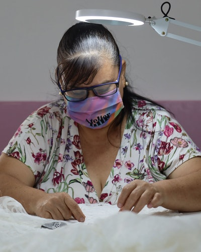 Lupita Jaimes Sedano working on a dress.