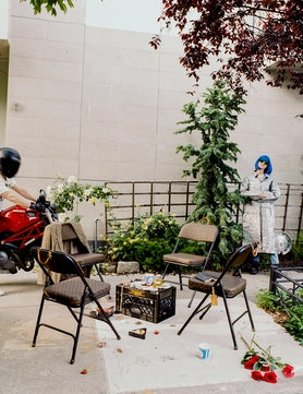 Sarah Coleman (far right), with folding  chairs of her own design and a jacket by Ari Serrano (on ch...