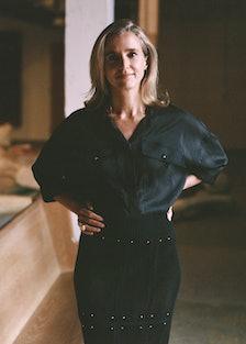 Lili Chopra wears an Hermès shirt and skirt; her own jewelry. Hair by Walton Nunez for See Managemen...
