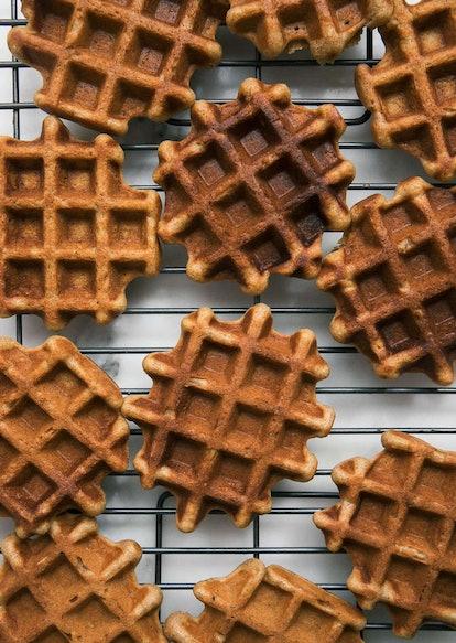 Cooling rack full of pumpkin waffles