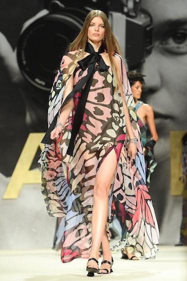 Model walks Chanel spring 2022 show in butterfly print dress