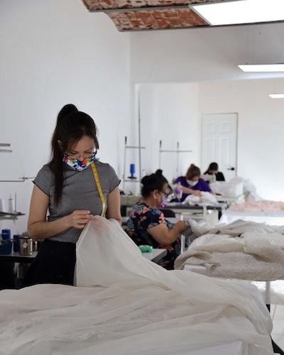 People working at Nadia Manjarrez Studio Bridal headquarters.