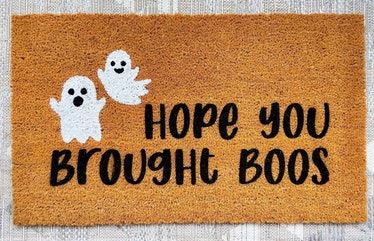 These Halloween doormats include hand painted designs from Etsy.