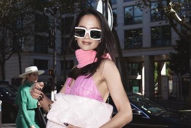 Anna Rosa Vitiello in pink top and white sunglasses at the Miu Miu spring 2022 show at Paris Fashion...