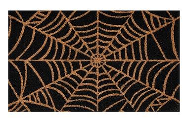 These Halloween doormats include a classic spiderweb design.