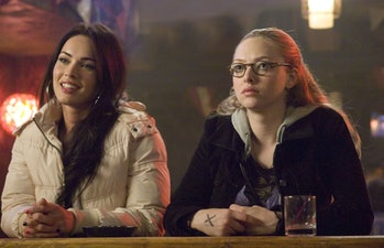 Jennifer (Megan Fox) and Anita (Amanda Seyfried) sit side by side in Jennifer's Body