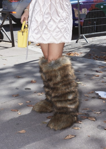 Showgoer in fuzzy Yeti boots outside the Miu Miu spring 2022 show at Paris Fashion Week.