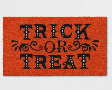 These Halloween doormats include a classic Trick-Or-Treat design.