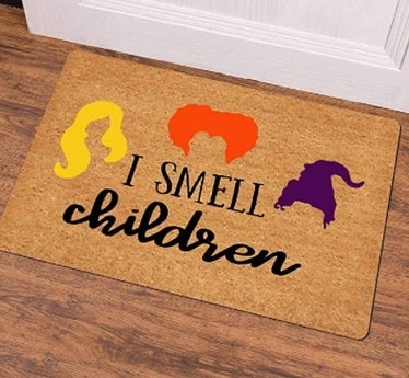 These Halloween doormats include cute and spooky options.