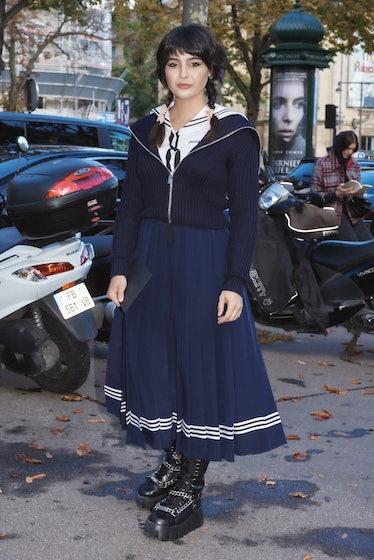 Maria Bernad in navy sailor skirt and top outside Miu Miu spring 2022 show at Paris Fashion Week.