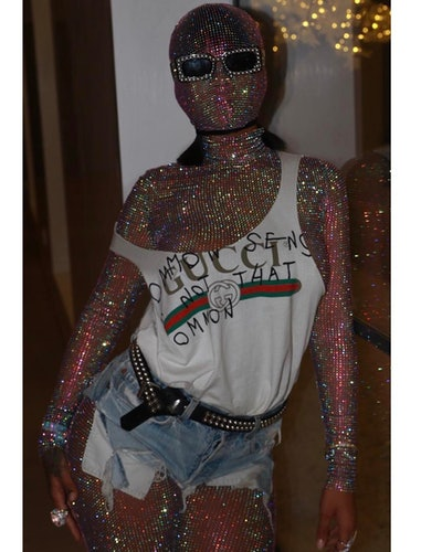 Rihanna in a Gucci glitter catsuit, tank top, and denim cutoffs.