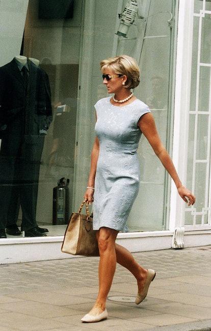 Princess Diana carrying Gucci tote bag.