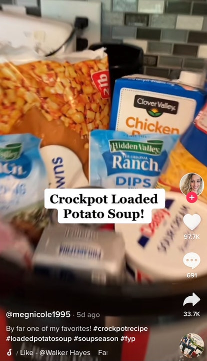 A woman shows off how to make TikTok's viral crockpot potato soup with all the ingredients in the cr...