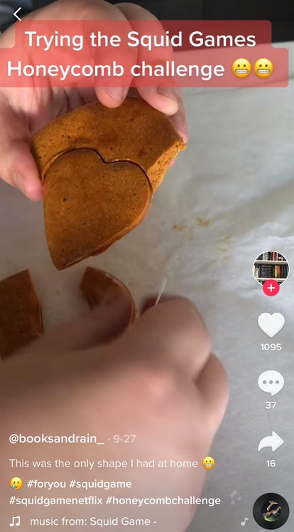A TikTok user plays the 'Squid Game' honeycomb challenge with dalgona candy.