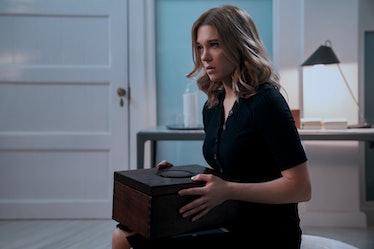 Dr Madeleine Swann holding a box