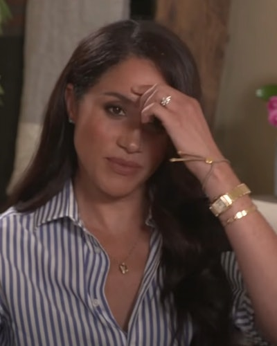 Meghan Markle wearing Princess Diana's gold Cartier tank watch in an interview for Fortune's Most Po...