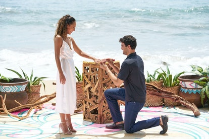 The 'Bachelor In Paradise' couple seemed a little stiff as they got engaged during the finale.