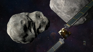 A spacecraft approaching two asteroids in space.