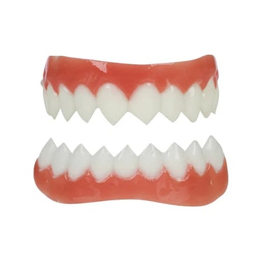 Fake sharp teeth are a big part of any 'AHS: Double Feature' costume.