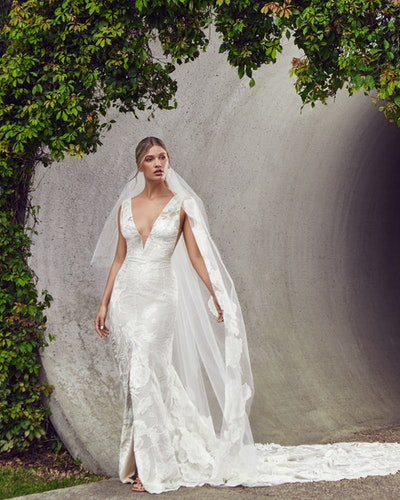 The Virginia cape gown from Nadia Manjarrez Studio Bridal.