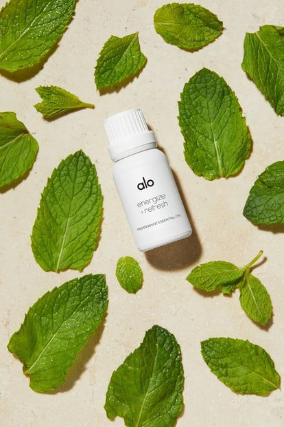 Alo Yoga Alo Wellness essential oil flatlay